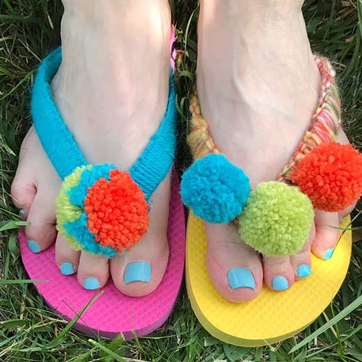 Flipflops with pompoms by Betz White