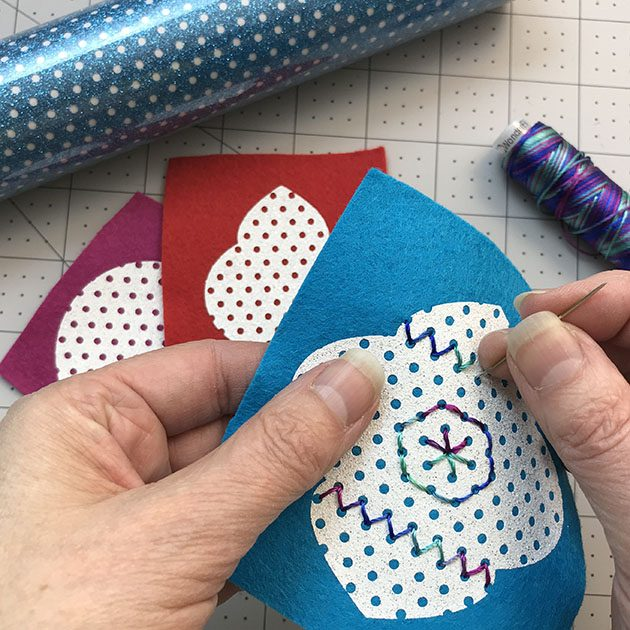 Stitching the glitter felt ornament by Betz White