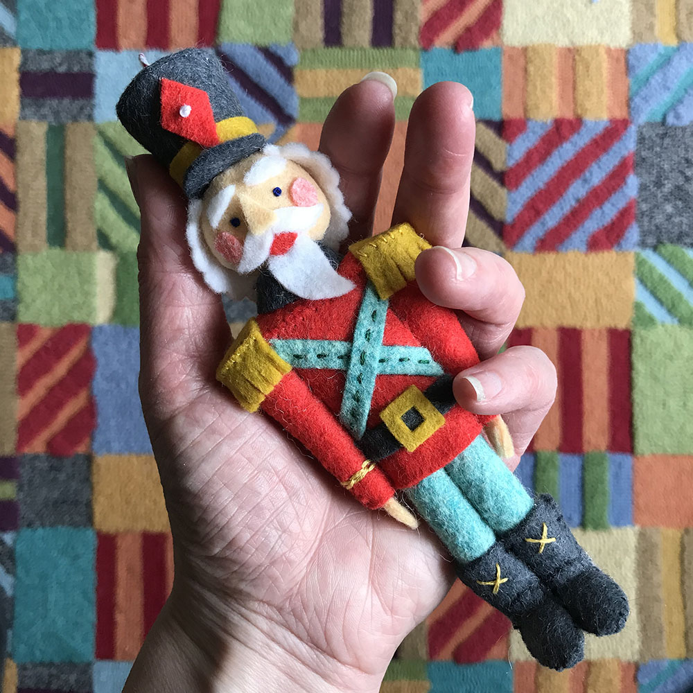 Nutcracker Ornament in hand