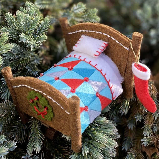 winters-nap-felt ornament by betz white